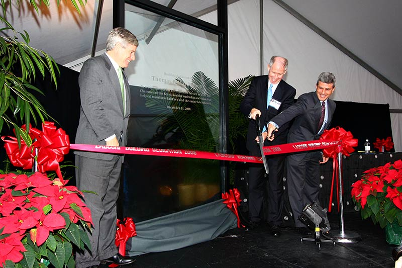 A ribbon-cutting event is held in 2008 for the new corporate headquarters in downtown Burlington, N.C. The headquarters building is named after former CEO Thomas P. Mac Mahon, pictured to the right with current LabCorp chairman and CEO David P. King.