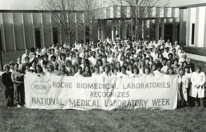 Employees at Roche Biomedical Laboratories (RBL) celebrating National Medical Laboratory Week. RBL and National Health Laboratories merged to become LabCorp in 1995.